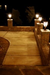 Lighted column walkway to front entrance of home